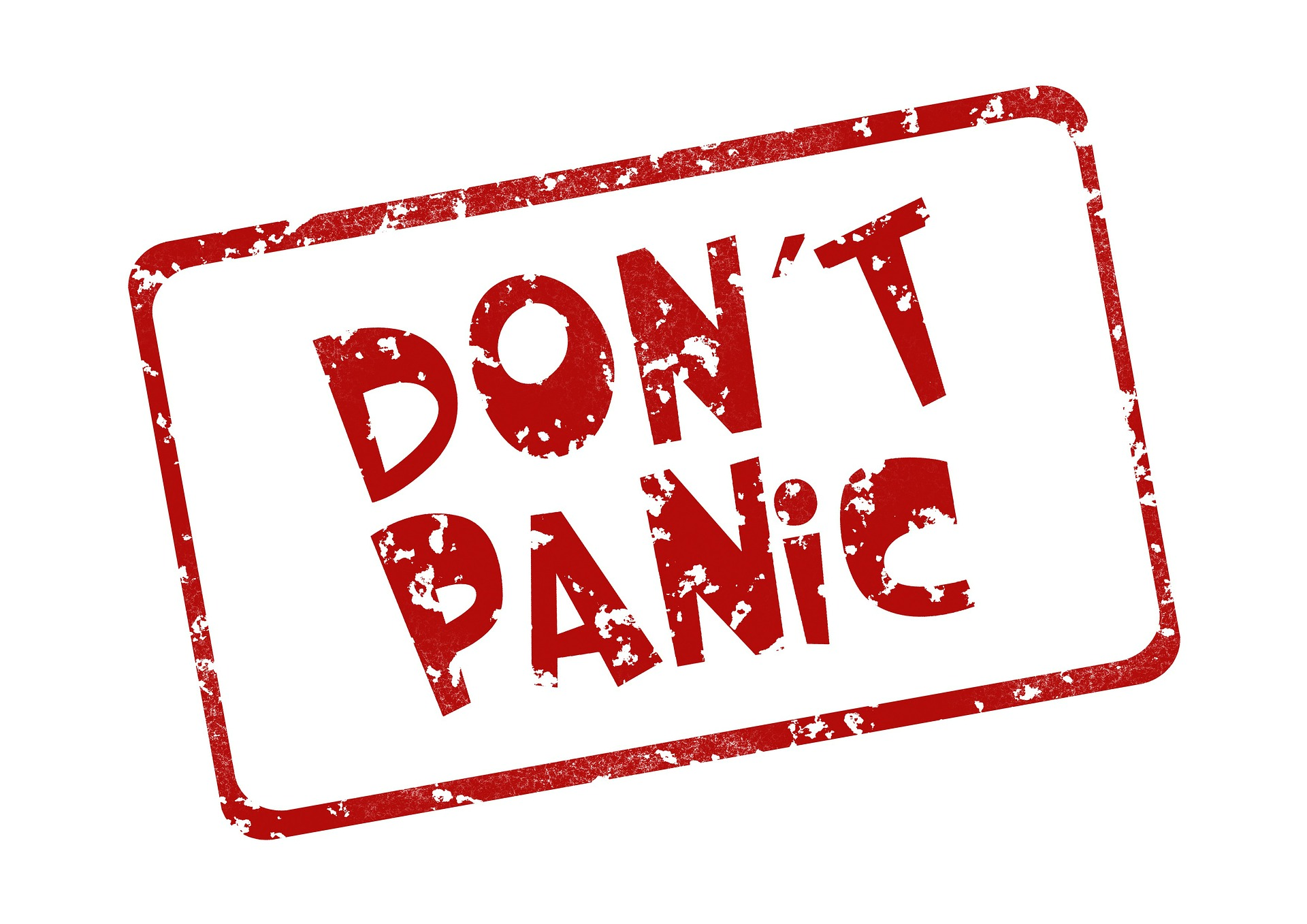 white sign with red border and red text with the words don't panic in relation to property tax statement